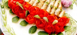 Spring rolls are decorated with roses made of tomatoes